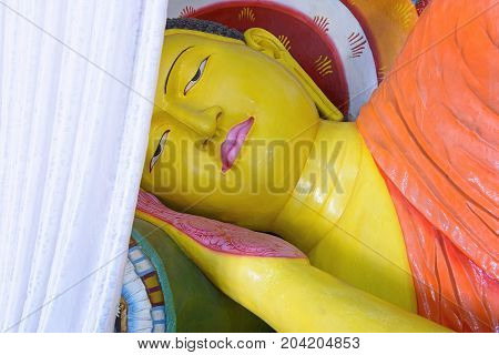 Reclining Buddha statue inside Abhayagiri Dagoba in Anuradhapura, Sri Lanka. Anuradhapura was a major monastery site of Buddhism and is one of the most extensive ruins in the world