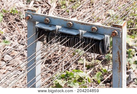 Detail of the metal cable pulley for use to control the signal traffic pole in the rural train station Thailand.