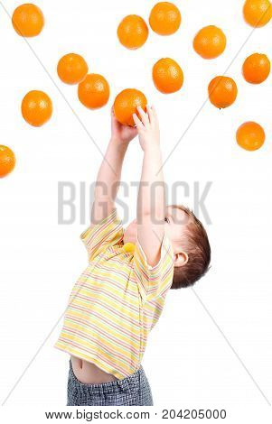 Boy Caughts Flying Oranges  Isolated On White Background