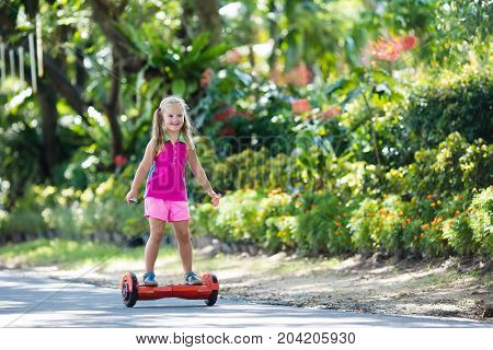Child On Hover Board. Kids Ride Scooter.