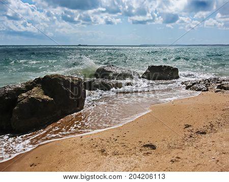 Sea waves beat on coastal rocks. Summer seascape
