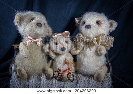 A Puppet Family Of Polar Bears Is Photographed In A Family Album