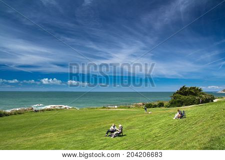 Woolacombe Devon England 14 July 2016: People rest and enjoy the good weather