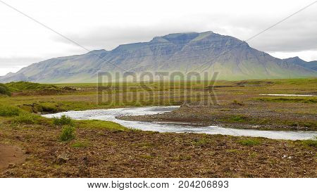 Winding river with mountains behind, Snaefellsnes peninsula, Iceland