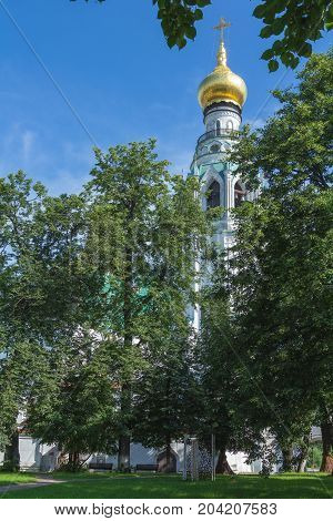 Belfry of St. Sophia Cathedral surrounded by green trees. Vologda. Russia