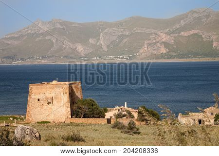The fortified tower next to the Tonnara of Monte Cofano near San Vito lo Capo in the Gulf of Macari in northern Sicily Italy