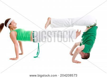 Contact Sport . Capoeira. combat over white background