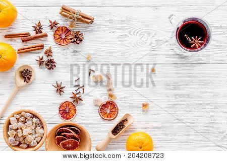 Ingredients of hot mulled wine or grog set with spices and citrus for winter evening. Christmas and new year eve. Light wooden background top view. Mock up
