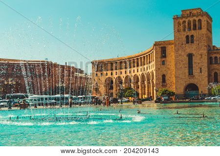Dancing Fountains and architectural complex on Republic Square. Touristic architecture landmark. Sightseeing in Yerevan. City tour. Government House. Travel and tourism concept. Sunny autumn day.
