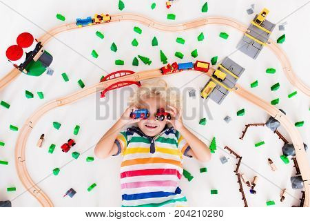 Child With Toy Train. Kids Wooden Railway.
