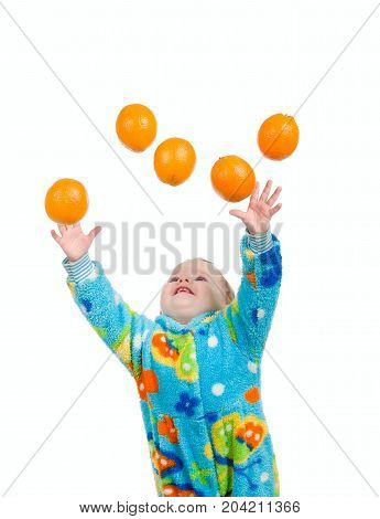 Little baby girl caughts orange . isolated on white background