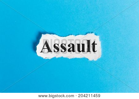 Assault text on paper. Word Assault on a piece of paper. Concept Image.