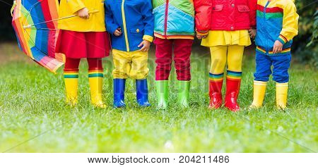 Kids In Rain Boots. Rubber Boots For Children.