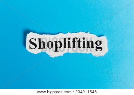 shoplifting text on paper. Word shoplifting on a piece of paper. Concept Image.