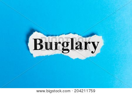 BURGLARY text on paper. Word BURGLARY on a piece of paper. Concept Image.
