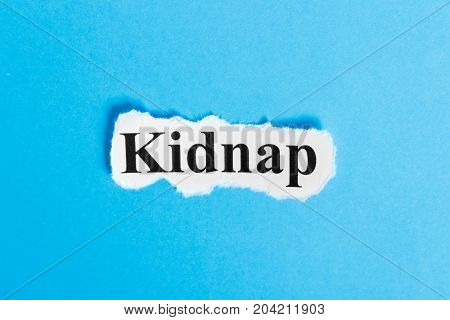 Kidnap text on paper. Word Kidnap on a piece of paper. Concept Image.