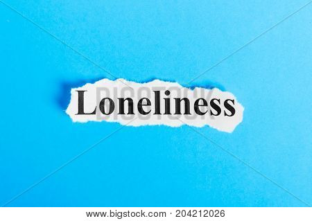 loneliness text on paper. Word loneliness on a piece of paper. Concept Image.