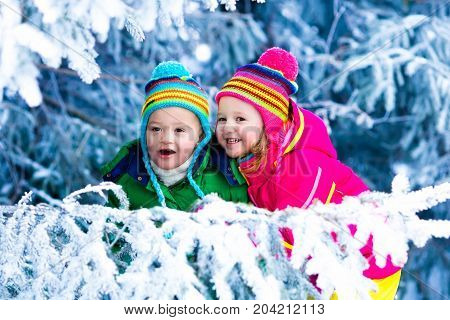 Kids Playing In Snowy Forest