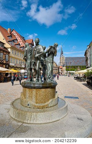 QUEDLINBURG, GERMANY - SEPTEMBER 07, 2017: the Fountain with the Muenzenberger musicians on the historical market square in the old town of Quedlinburg. The artwork created by Wolfgang Dreysse was inaugurated in 1976