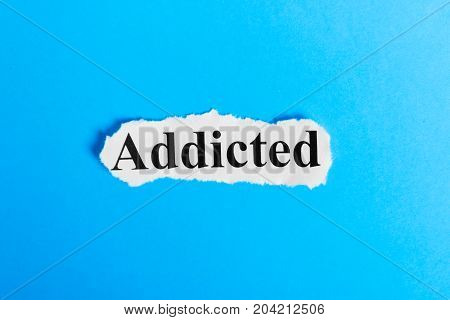 Addiction text on paper. Word Addiction on a piece of paper. Concept Image.