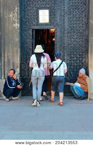 Lviv - 03 August 2013 / Ukraine: Two homeless people earn their living by begging at church doors in Lviv. 03 August 2013 in Lviv, Ukraine.