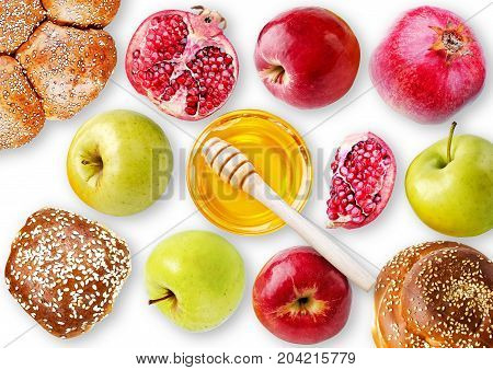 Still life View from above - challah apples pomegranate and bowl of honey isolated on a white background. Illustration of Rosh Hashanah (jewish new year) or Savior of the Apple Feast Day