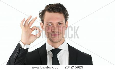 Okay Sign By Young Businessman Isolated On White Background
