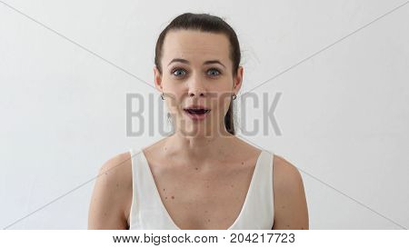 Amazed Beautiful Young Woman By Surprise, Portrait In Designer Office