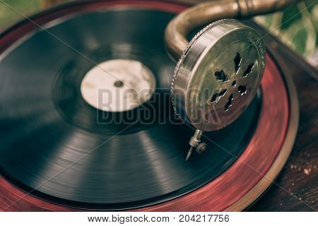 Vintage gramophone with a vinyl, selective focus, toned