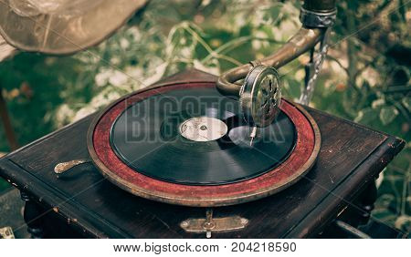 Beautiful vintage phonograph to listen vinyl, toned
