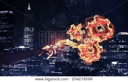 Fire burning gear mechanism on night city background