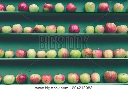 Fresh red and green apple healthy fruit stall in market shelf