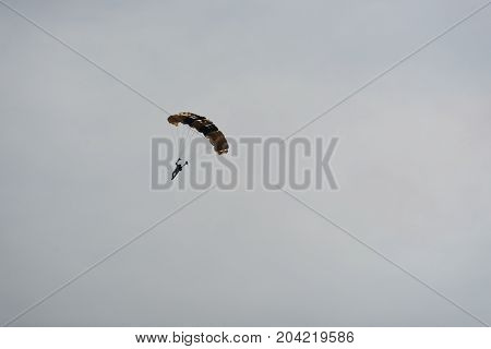 Parachutist In The Sky On A Cloudy Day