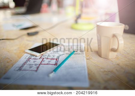 Statistics. Phone, pencil and cup. It's all real office worker need. Start up concept.
