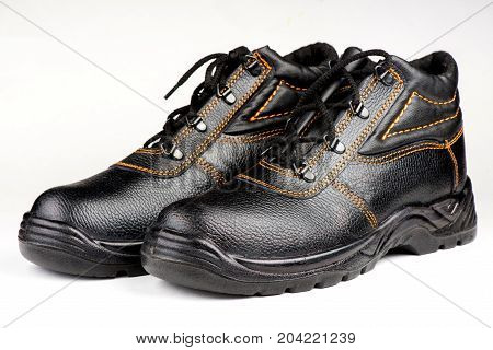 work boots on a white background, working boots with protection