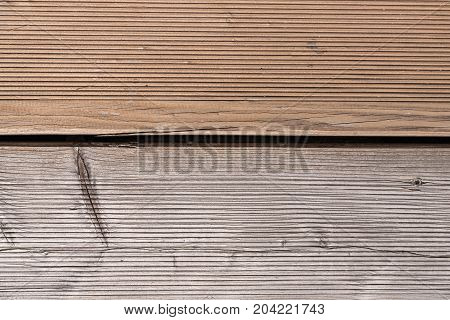 Wooden floor with larch wood of different age - close-up contrast