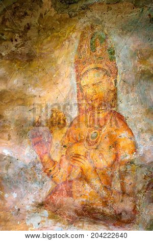 Two Sigiriya maiden with fruits. One of the ancient frescoes at the ancient rock fortress of Sigiriya, a UNESCO World Heritage Site in Sri Lanka