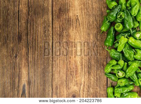 Portion Of Raw Pimientos On Wooden Background, Selective Focus