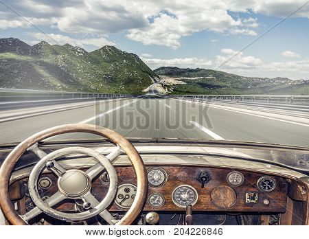 Retro car on the highway. View from the cockpit.