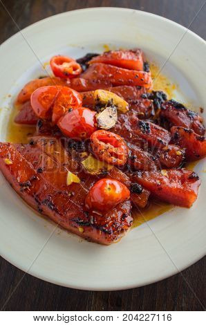 Grilled watermelon with fresh roasted garlic and grape tomatoes
