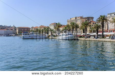 SPLIT, CROATIA - JULY 12, 2017: Embankment and yachts on the pier of Split, Croatia