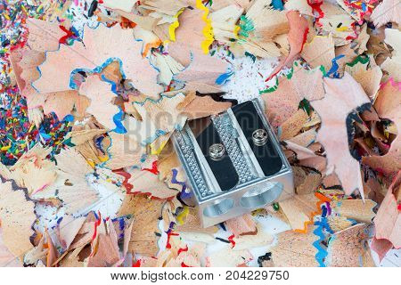 Color shavings and metal sharpener on it