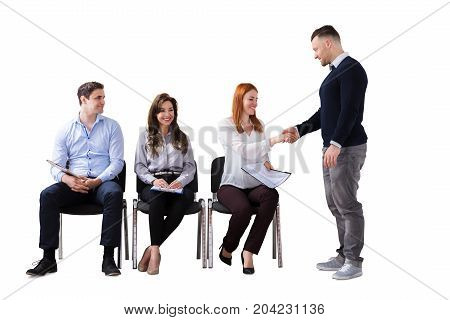 Businessman Shaking Hands With Woman Besides People Waiting For Job Interview