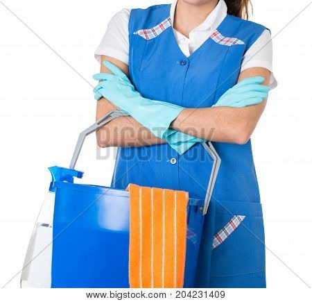 Close-up Of Female Janitor With Cleaning Equipments Against White Background
