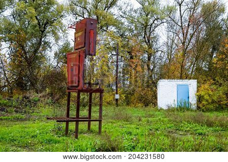 Old Rusty Electric Transformer In The Park. Electric Transformer Box.