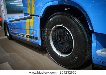 MOSCOW, SEP, 5, 2017: Close up side view on blue bolster-type truck Volvo FH 540 exhibit on Commercial Transport Exhibition ComTrans-2017. Volvo trucks. Automobile industry last achivements