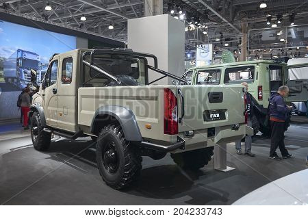 MOSCOW, SEP, 5, 2017: View on russian off road car GAZ for for hard to reach areas and hunting. Special customized tailor made off road mud truck. Commercial Transport Exhibition ComTrans-2017 booth