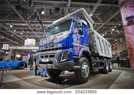 MOSCOW, SEP, 5, 2017: View on Volvo dump truck exhibit on Commercial Transport Exhibition ComTrans-2017. Volvo commercial transport on exhibition stand. New dump trucks cars. Truck close up