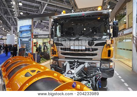 MOSCOW, SEP, 5, 2017: View on gray orange city service snowplow truck Scania exhibit on Commercial Transport Exhibition ComTrans-2017. Automobile industry of service and commercial trucks