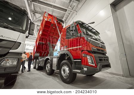 MOSCOW, SEP, 5, 2017: View on Volvo dump truck exhibit on Commercial Transport Exhibition ComTrans-2017. Volvo commercial transport on exhibition stand. Dump trucks cars